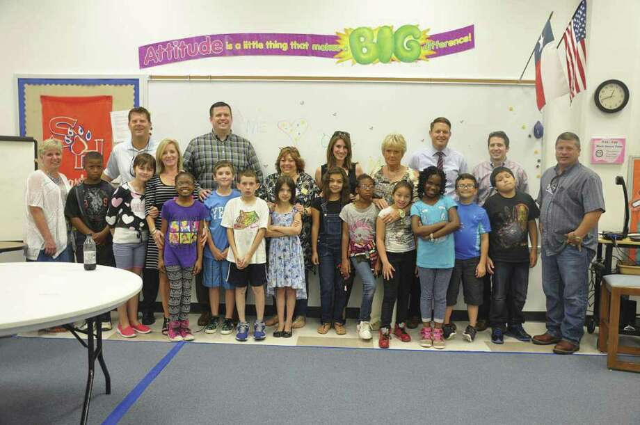 Some of the Conroe Noon Lions Club monitors pictured with their students when the program began in 2015 at their adopted school of Reaves Elementary.
