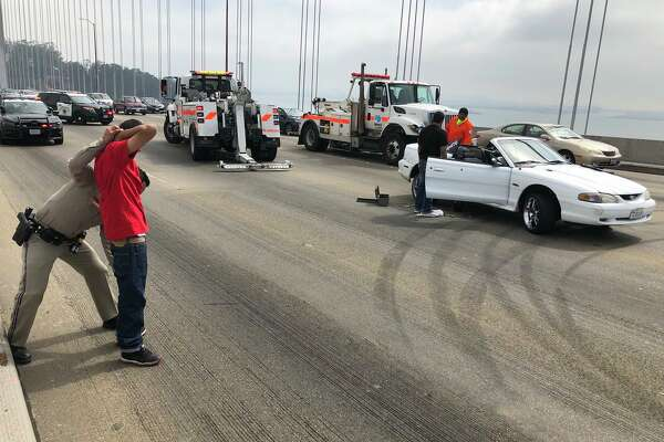 A driver was arrested after a sideshow broke out Sunday morning on the Bay Bridge.