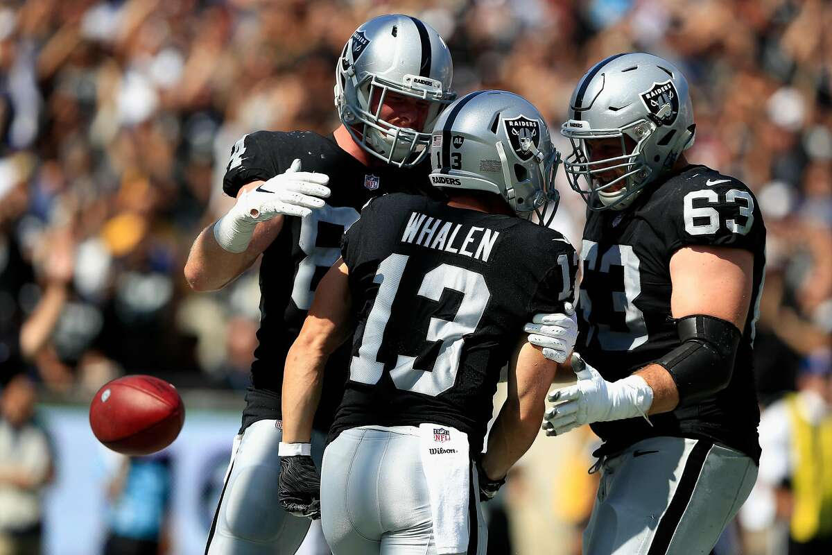LOS ANGELES, CA - AUGUST 18: Cameron Hunt #63 and Paul Butler #84 congratulate Griff Whalen #13 of the Oakland Raiders on his touchdown during the second half of a preseason game against the Los Angeles Rams at Los Angeles Memorial Coliseum on August 18, 2018 in Los Angeles, California. (Photo by Sean M. Haffey/Getty Images)