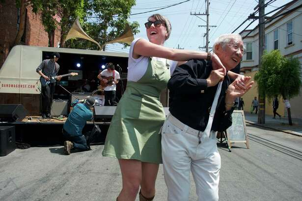 Megan Magick and Charlie Guo dance to the surf rock of the band Mint at Noise Pop's 20th Street Block Party.