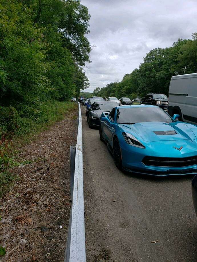 "State police stopped and ticketed 10 ""racing-type cars"" that were traveling slowly on the Wilbur Cross Parkway as they were being filmed by the lead car, blocking traffic. Photo: Contributed Photo / Connecticut State Police"