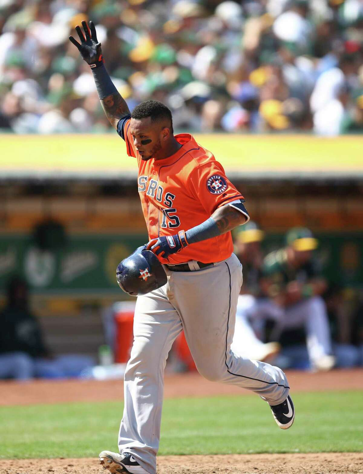 Houston Astros' Martin Maldonado celebrates after hitting a home run off Oakland Athletics' Emilio Pagan in the seventh inning of a baseball game Sunday, Aug. 19, 2018, in Oakland, Calif. (AP Photo/Ben Margot)