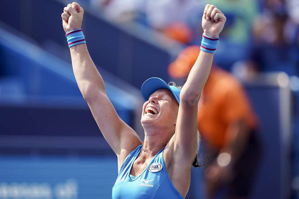 Kiki Bertens, of the Netherlands, celebrates after defeating Simona Halep, of Romania, during the finals at the Western & Southern Open tennis tournament, Sunday, Aug. 19, 2018, in Mason, Ohio. (AP Photo/John Minchillo)