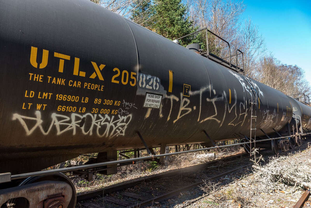 An old DOT-111 oiltankerparked on a section of the Saratoga and North Creek rail line in the Adirondacks.