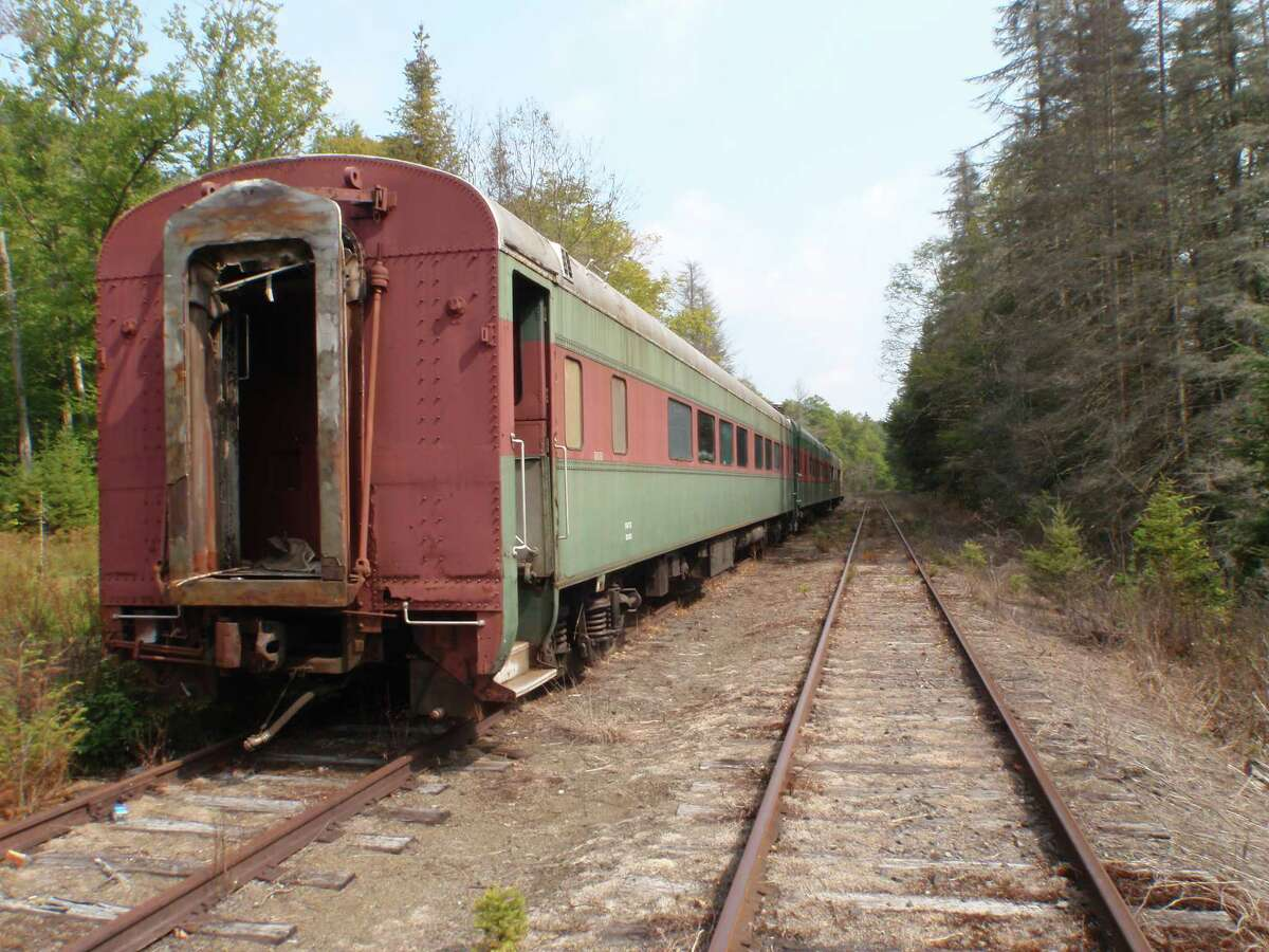 Old passenger cars stored on Saratoga and North Creek rail lines in the Adirondack High Peaks gradually fall victim to vandals and decay.