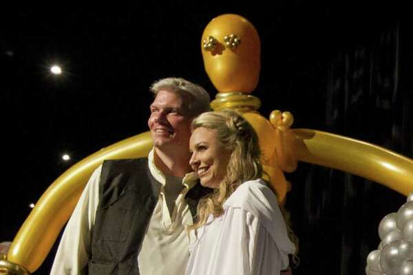 J.J. Hollie, president of The Woodlands Area Chamber of Commerce, and his wife Amy poses next to a baloon version of C-3PO and R2D2 during the annual The Woodlands Area Chamber of Commerce Chairman's Ball at The Woodlands Marriott Hotel & Convention Center on Saturday, Aug. 18, 2018, in The Woodlands. The event honored outgoing chairman Frank Holmes and welcomed incoming chairman Stuart Lapp.