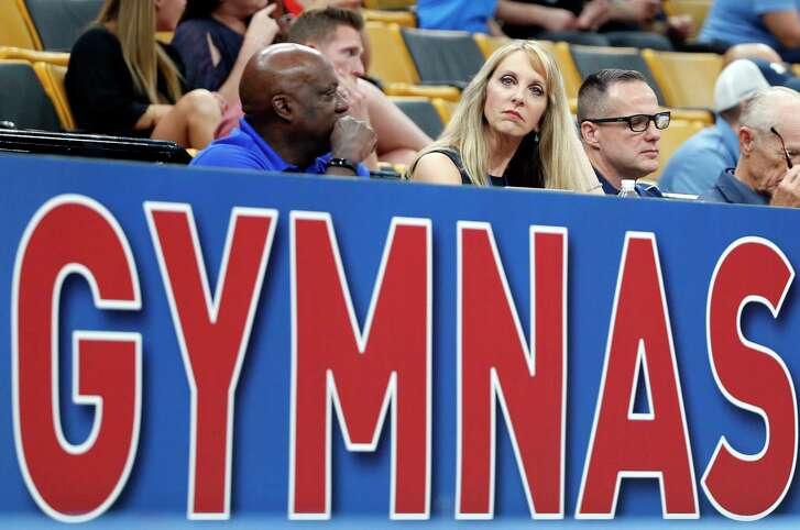 USA Gymnastics President and CEO Kerry Perry, middle, watches the U.S. Gymnastics Championships, Thursday, Aug. 16, 2018, in Boston. (AP Photo/Elise Amendola)