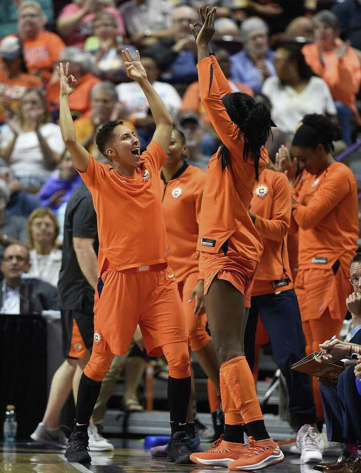 Connecticut Sun guard Layshia Clarendon, left, and forward Chiney Ogwumike celebrate on the bench during Sunday's game against the Sparks. Photo: Sean D. Elliot / Associated Press / 2018 The Day Publishing Company