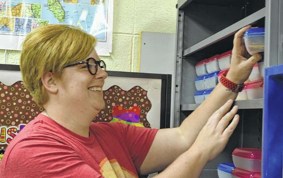Bailey Brammeier prepares her classroom for the first day of school. Photo:       Samantha McDaniel-Ogletree | Journal-Courier