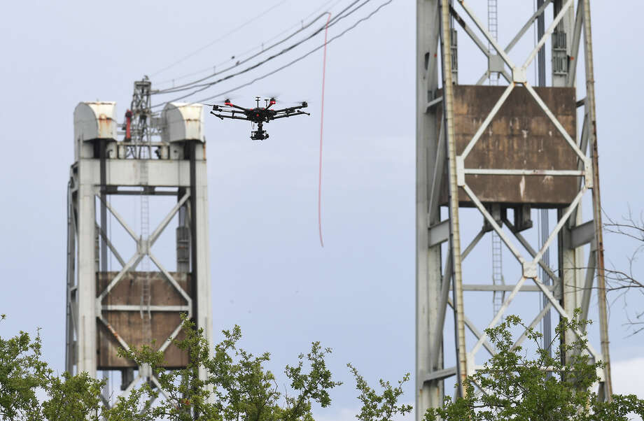 Beaumont Police's Matrice drone hovers near the Neches River on Tuesday. The drone is outfitted with a 30x zoom camera and a thermal imaging camera. The device is used for search and rescue as well as keeping officers out of harms way.   Photo taken Tuesday, 8/7/18 Photo: Guiseppe Barranco/The Enterprise / Guiseppe Barranco ?