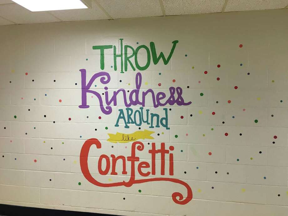 Volunteers painted inspirational messages on the walls of Huckleberry Hill Elementary School. Photo: / Contributed Photo