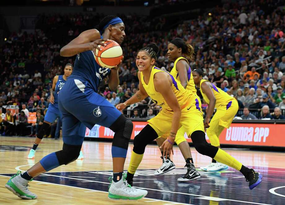 Los Angeles Sparks forward Candace Parker (3) guardsMinnesota Lynx center Sylvia Fowles (34) during the second half of a WNBA basketball game Thursday, July 5, 2018, in Minneapolis. (Aaron Lavinsky/Star Tribune via AP) Photo: AARON LAVINSKY, Associated Press / ' 2018 Aaron Lavinsky /Star Tribune
