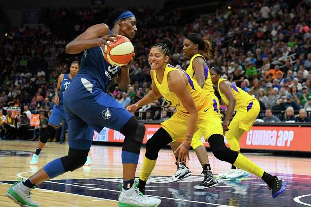 Los Angeles Sparks forward Candace Parker (3) guardsMinnesota Lynx center Sylvia Fowles (34) during the second half of a WNBA basketball game Thursday, July 5, 2018, in Minneapolis. (Aaron Lavinsky/Star Tribune via AP)