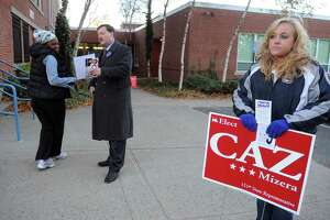 Caz Mizera, center, candidate for State Representative, greets Latoya Miller as she enters to vote in Stratford on November 2, 2010.