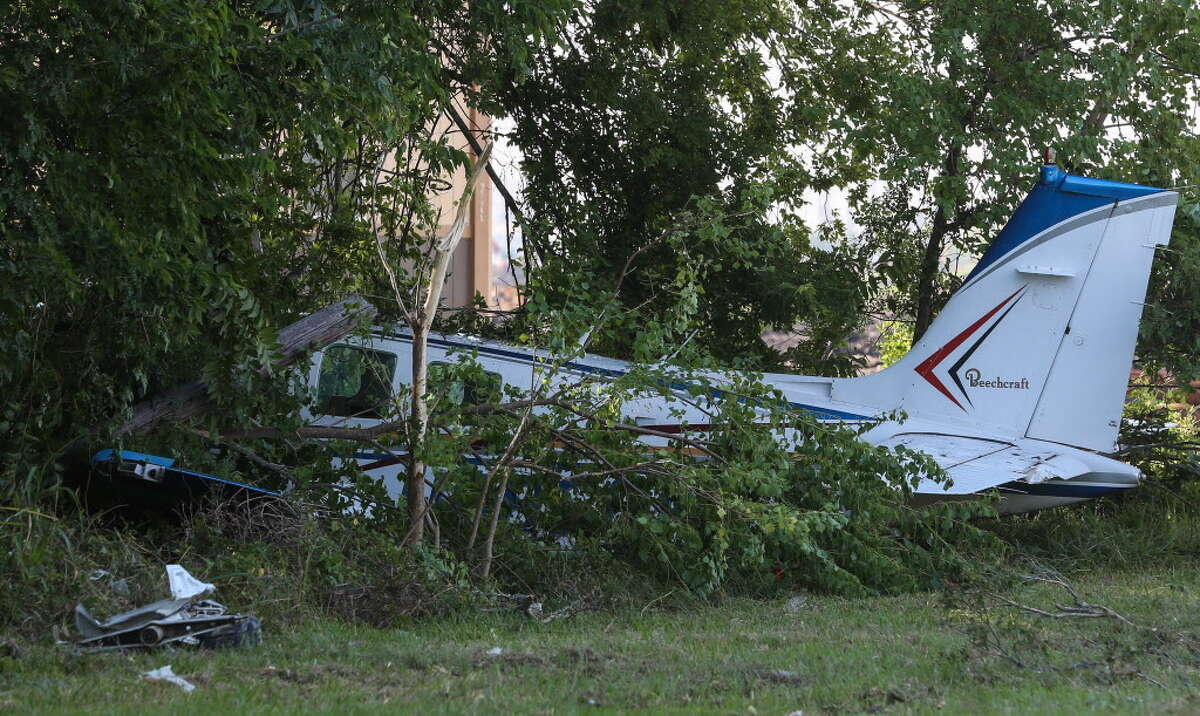 A small plane crashed into woods on Boyett Street across the street from La Porte Municipal Airport on Monday, Aug. 20, 2018, in La Porte. The pilot, who was in the only person on he plane, was not injured and walked out of the plane after the crash. The plane knocked a mini-storage unit while landing.