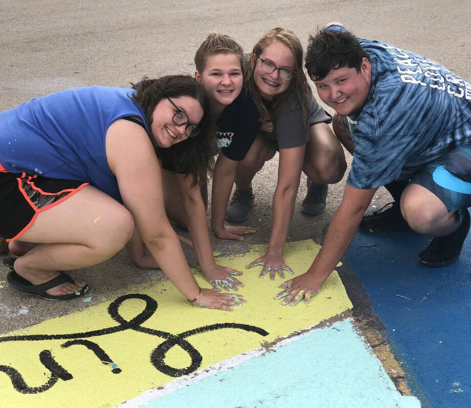 Parking spaces: Lindsey McGlothlin, from left, Addy Allison, Alexis Opachan and Evan Arp Photo: Courtesy Photo