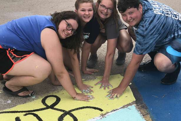 Parking spaces: Lindsey McGlothlin, from left, Addy Allison, Alexis Opachan and Evan Arp