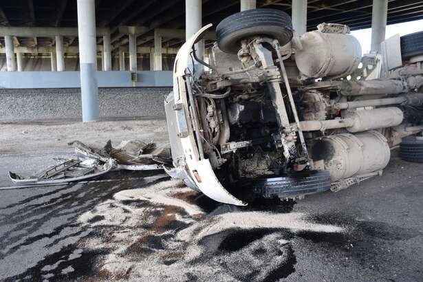A gravel truck rolled over on Monday, Aug. 20, 2018, after its driver took the turn at General Hudnell Drive under U.S. 90. too fast, police said.
