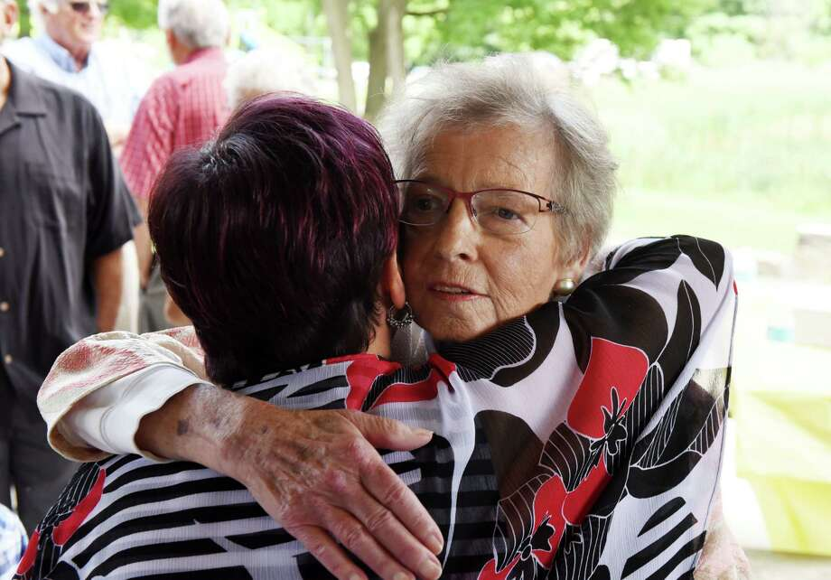 Karen Johnson, right, is embraced by Schenectady Councilwoman Leesa Perazzo, left, after being presented with the Patroon Award on Monday, Aug. 20, 2018, at Steinmetz Park in Schenectady, N.Y. The Patroon Award is the highest honor the City of Schenectady can bestow upon its residents. (Will Waldron/Times Union) Photo: Will Waldron, Albany Times Union / 20044608A