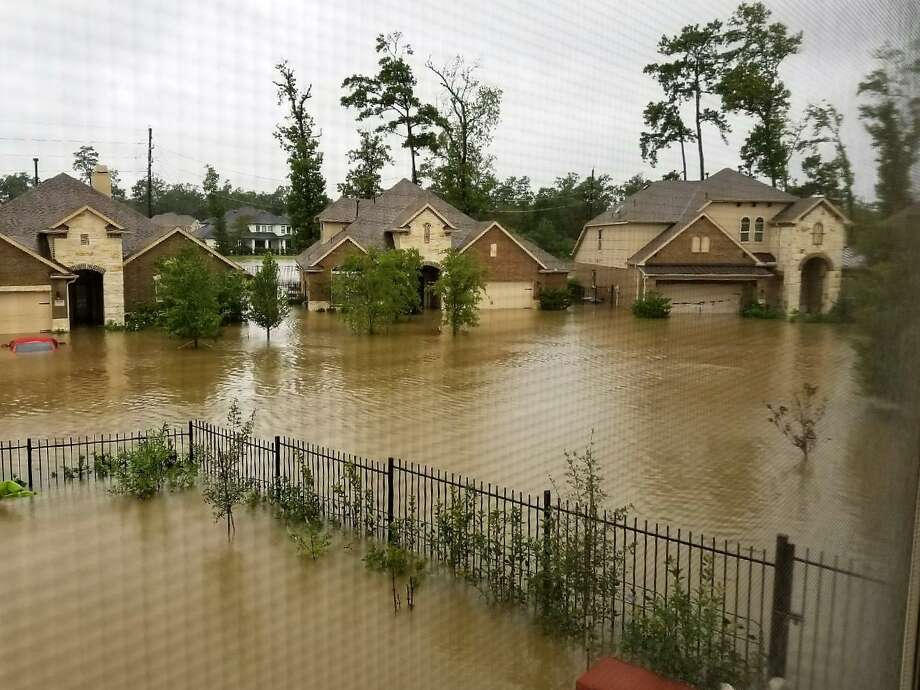 At the Drainage Task Force Meeting at The Woodlands Township Tuesday, Oct. 23, Zach Toups, representing the Harris-Montgomery Counties MUD 386, said they are still evaluating the feasibility of a flood barrier around parts of their Creekside Park neighborhood. In this file photo, flooding in The Woodlands during Hurricane Harvey is seen from the second story of the home of Stanley Okazaki, the founder of the group Stop The Flooding In MUD 386. More than 300 homes were flooded in the Timarron and Timarron Lakes area during Harvey. Photo: Handout::Stanley Okazaki