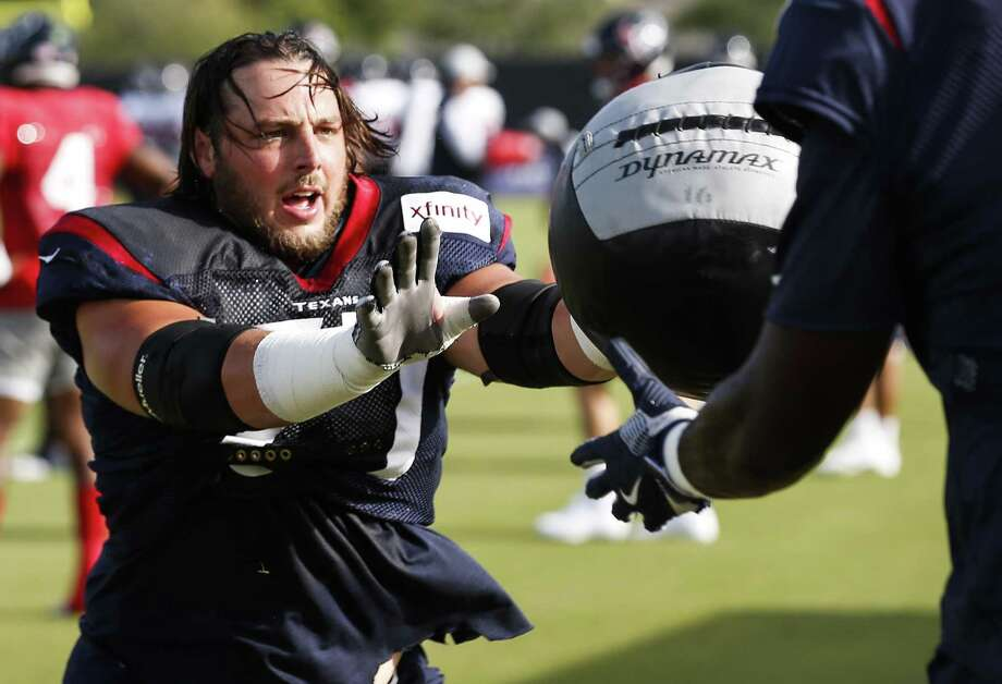 Houston Texans offensive guard David Quessenberry (77) hits a medicine ball during a drill at training camp at the Methodist Training Center on Tuesday, Aug. 14, 2018, in Houston. Photo: Brett Coomer, Staff Photographer / Staff Photographer / © 2018 Houston Chronicle