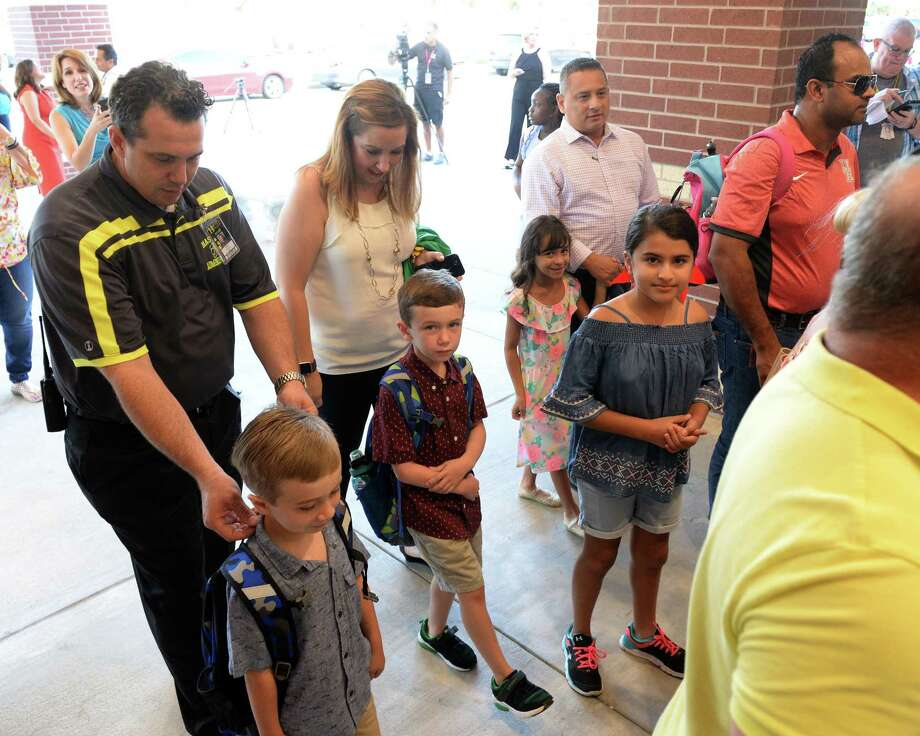 Parents accompany students arriving at Katy ISD's Betty Sue Creech Elementary for the first day of the 2018-19 school year on August 15, 2018, Katy, TX. Photo: Craig Moseley, Staff / Chronicle / ©2018 Houston Chronicle
