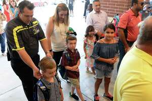 Parents accompany students arriving at Katy ISD's Betty Sue Creech Elementary for the first day of the 2018-19 school year on August 15, 2018, Katy, TX.