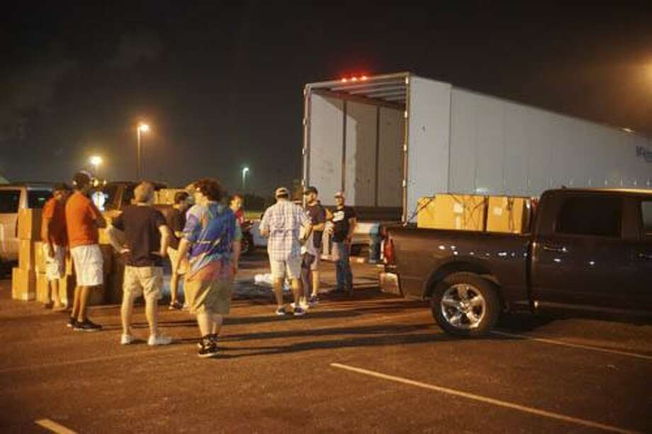 JDRF Houston Gulf Coast Chapter members worked together to unload 3,750 pounds of diabetic medical supplies from a semi. The supplies were disbursed to those living with Type 1 diabetes that were affected by Hurricane Harvey. Photo: Courtesy Photo