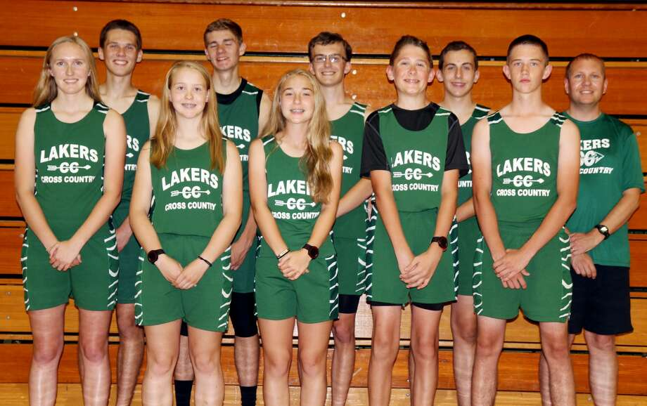p.p1 {margin: 0.0px 0.0px 0.0px 0.0px; font: 18.0px Helvetica} Members of the Elkton-Pigeon-Bay Port cross country team are (front row from left) Heather Rooney, Ern McArdle, Maya Viers, Alex Smith and Jared Chandler (back row) Andrew Smith, Travis Fritz, Colin Truemner, Mason Williams and coach Mike Klosowski. (Mike Gallagher/Huron Daily Tribune) Photo: Tribune Staff