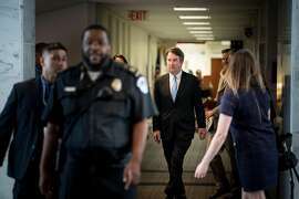 Judge Brett Kavanaugh, President Donald Trump's supreme court nominee, walks to a meeting on Capitol Hill in Washington, Aug. 15, 2018. As a young lawyer investigating President Bill Clinton�s affair with Monica Lewinsky, Kavanaugh urged prosecutors to question him in graphic detail about his sexual relationship, according to a memorandum released on Aug. 20, 2018. (Erin Schaff/The New York Times)