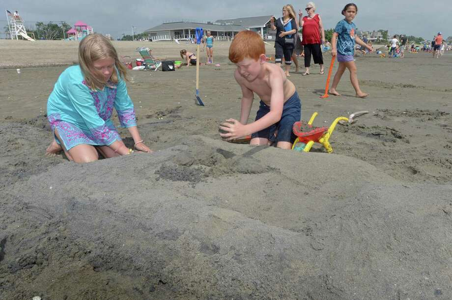 Ellie and Colin Davis, 12 and 10, participate in the annual PAL Sand Sculpting Contest Saturday, August 18, 2018, at Penfield Beach in Fairfield, Conn. Prizes were awarded for Best Castle, Most Original, Most Artistic, and Most Realistic sculpture. Photo: Erik Trautmann / Hearst Connecticut Media / Norwalk Hour