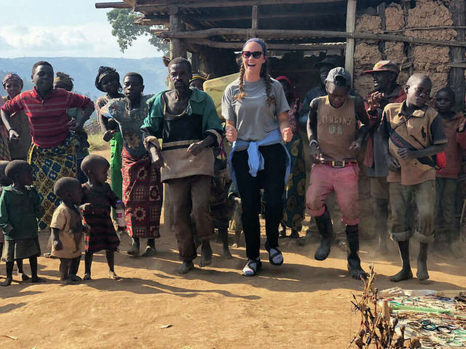 SIUE's Cheyenne Durham, of Swansea, joins dancers at the Batwa village students visited on Lake Bunyonyi during their travels study program in Uganda. Photo:       For The Telegraph