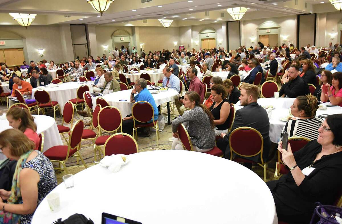 A roomful of people listen as New York State Office of Alcoholism and Substance Abuse Services (OASAS) Commissioner Arlene Gonz‡lez-S‡nchez speaks during the 2018 NYS Recovery Conference at the Albany Marriott on Monday, Aug. 20, 2018 in Albany, N.Y. (Lori Van Buren/Times Union)