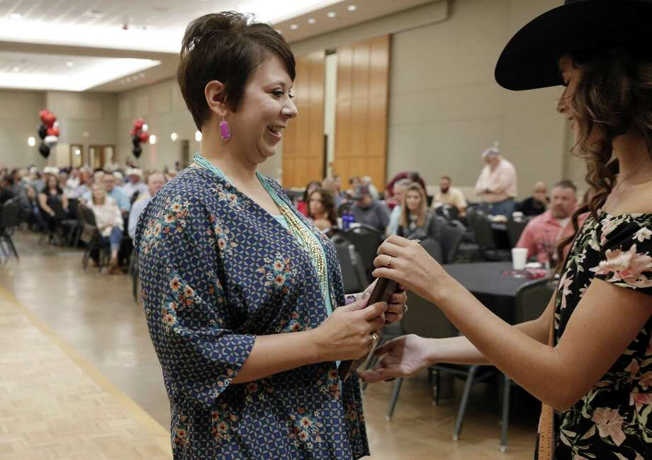 Michelle Bischof accepts her award for Commiteeman of the Year during the MCFA Appreciation Party and Casino Night held at the Lone Star Convention and Expo Saturday, Aug. 18, 2018 in Conroe, Texas. Photo: Michael Wyke / Contributor / © 2018 Houston Chronicle