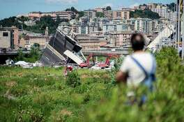 A resident views the Morandi motorway bridge after it partially collapsed in Genoa, Italy, on Aug. 15, 2018.