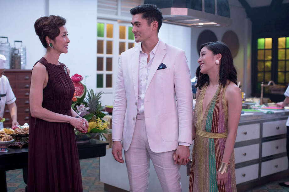 "(L-r) Michelle Yeoh, Henry Golding and Constance Wu star in ""Crazy Rich Asians."" Photo: Sanja Bucko, Warner Bros. Pictures / © 2017 Warner Bros. Entertainment Inc. and RatPac-Dune Entertainment LLC"