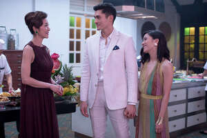 "(L-r) Michelle Yeoh, Henry Golding and Constance Wu star in ""Crazy Rich Asians."""