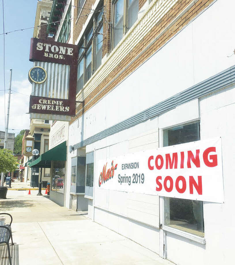 Alton businessman Mac Lenhardt told The Telegraph that he recently closed on a three-story/three-storefront commercial building at 114 W. Third St. in historic Downtown Alton, to open an expanded Mac's Downtown Alton next spring. The building is located around the corner from his current business at 315 Belle St. The new space will be connected internally to the existing space. Photo: Jill Moon | The Telegraph