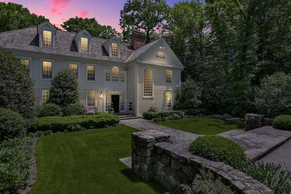 This elegant 8,220-square-foot colonial house was once owned by John Henry, the primary owner of the Boston Red Sox.