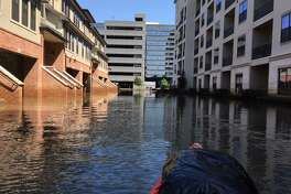 Lori Jackson Smith's husband, Bryan Smith, returns by kayak to pick up items. Parkside at Memorial, a complex of apartments & townhomes in the Energy Corridor, flooded with over 5 feet of water after the Barker and Addicks Reservoirs were released.