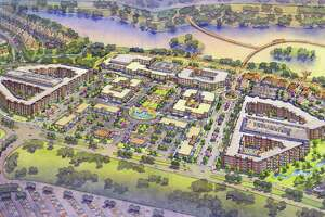 Katy's boardwalk project is located next to Katy Mills Mall and features an estimated 2.5-mile path across an 80-foot pond, a hotel and 55,000-square-foot convention center and a retail plaza.