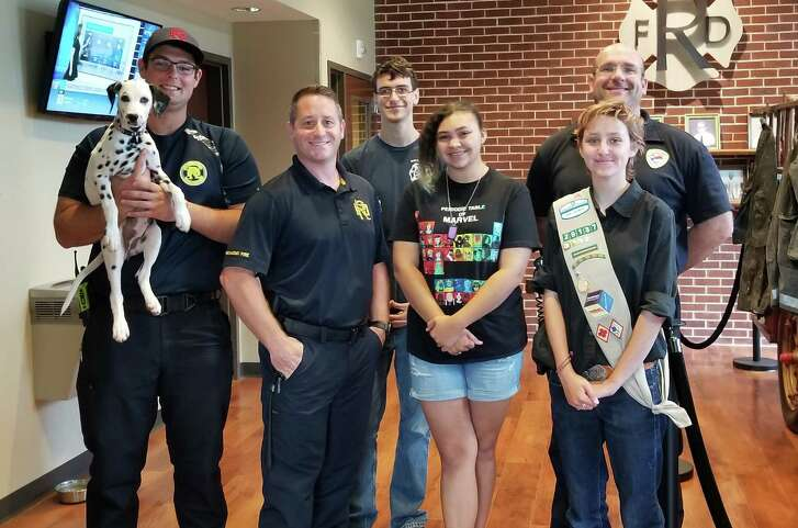 Members of the Richmond Fire Department recently learned the basics of sign language to help them in working with those who are hearing impaired. From left are: Lady IV, Firefighter Paxton Densmore, Battalion Chief Bryan Lewis, Sign language Team member Cameron Grant, Ruth Murray, Lead Instructor Megan Welty and Lt. Corey Gless.