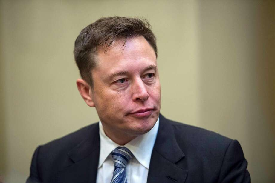 (FILES) In this file photo taken on January 23, 2017 CEO Elon Musk listens to US President Donald Trump speak during a meeting with business leaders in the Roosevelt Room at the White House in Washington, DC. - Tesla Motors dropped in early trading on August 20, 2018 due to rising doubts about Chief Executive Elon Musk's plans to take the electric carmaker private. Shares fell 2.6 percent to $297.55 about 20 minutes into trading, continuing the company's downward trajectory after Musk surprised markets on August 7 by announcing on Twitter he wanted to take Tesla private. (Photo by NICHOLAS KAMM / AFP)NICHOLAS KAMM/AFP/Getty Images Photo: NICHOLAS KAMM, AFP/Getty Images