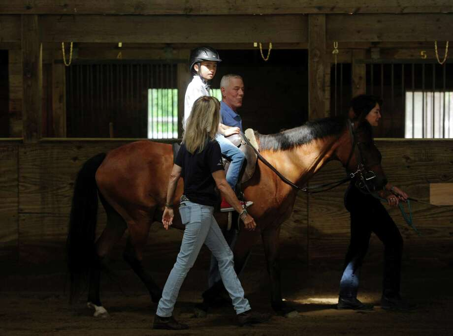 Mark Fontana, 9, of Rye, N.Y., rides a horse, Irish Lad, during a Pegasus Therapeutic Riding lesson at Kelsey Farm in Greenwich, Conn. Tuesday, Aug. 14, 2018. Pegasus is a PATH-accredited therapeutic riding center for people with special needs with chapters in Putnam and Fairfield counties, including the 20-acre Pegasus Farm in Brewster, N.Y. Photo: Tyler Sizemore / Hearst Connecticut Media / Greenwich Time