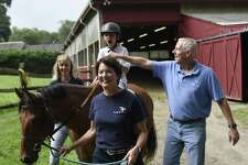 Mark Fontana, 9, of Rye, N.Y., rides a horse, Irish Lad, beside volunteer Trish White, left, Director of Volunteer Services Lynn Peters, and PATH registered instructor Jeff Hopkins during a Pegasus Therapeutic Riding lesson at Kelsey Farm in Greenwich, Conn. Tuesday, Aug. 14, 2018. Pegasus is a PATH-accredited therapeutic riding center for people with special needs with chapters in Putnam and Fairfield counties, including the 20-acre Pegasus Farm in Brewster, N.Y.