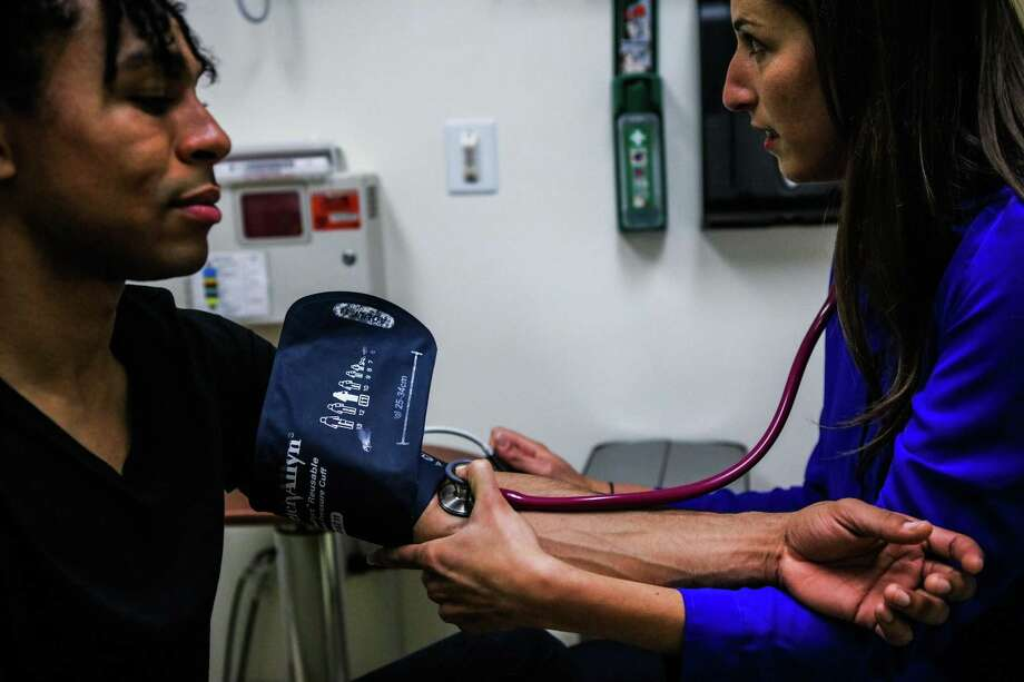 A patient has her blood pressure checked. Photo: Gabrielle Lurie / Special To San Francisco Chronicle / ONLINE_YES