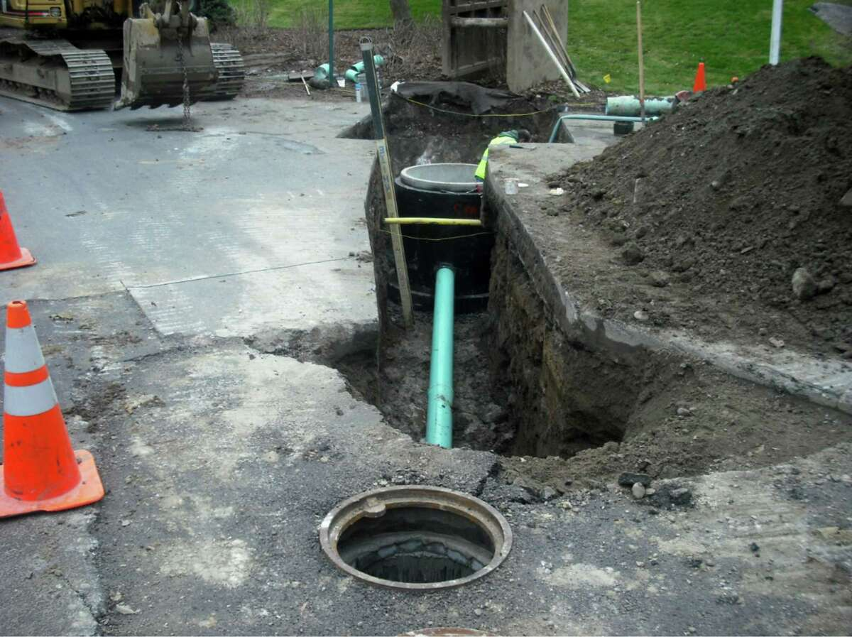 A new manholes are installed as part of the Clifton Park sewer rehabilitation project. (Saratoga County Sewer District 1)
