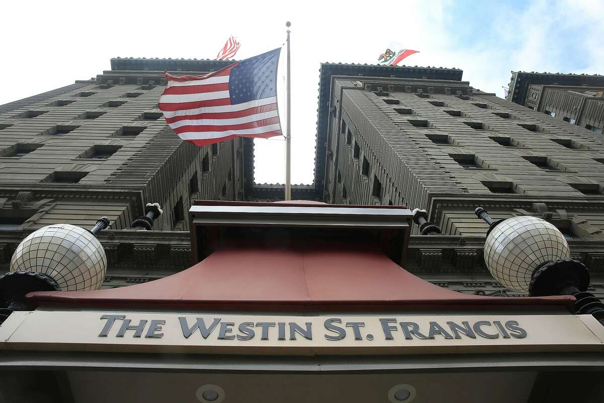 An American flag flies above Powell Street above an entrance to the Westin St. Francis on Monday, August 20, 2018 in San Francisco, Calif.