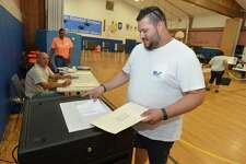 Guillermo Rojas casts his primary election vote at Kendall School in Norwalk on Tuesday.
