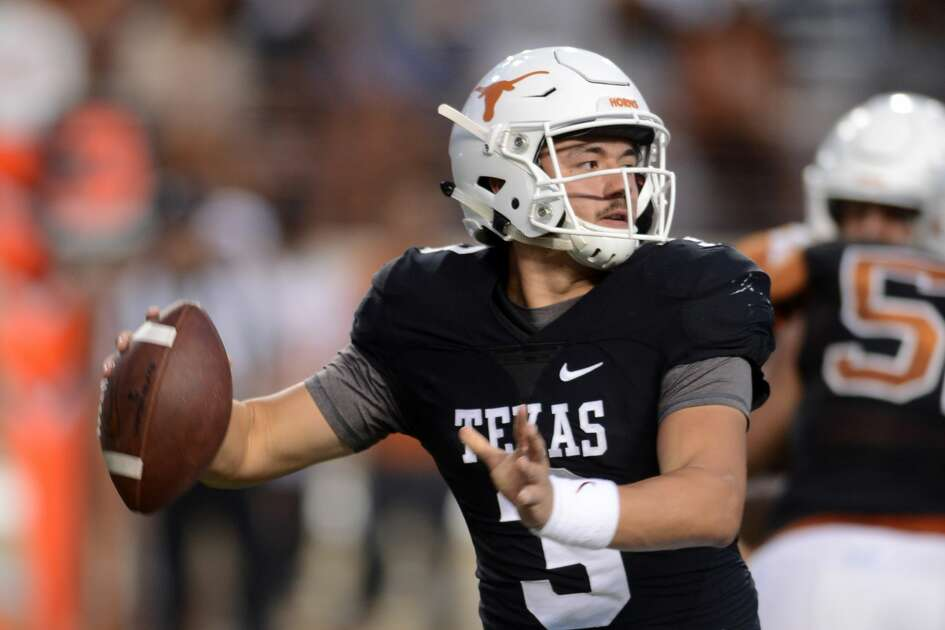 AUSTIN, TX - APRIL 21: Texas Longhorns freshman QB Cameron Rising passes during the orange and white spring game on April 21, 2018 at Darrell K Royal-Texas Memorial Stadium in Austin, TX. (Photo by John Rivera/Icon Sportswire via Getty Images)